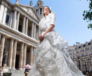 Ковід задав новий тренд: у Британії створили ексклюзивну весільну сукню з медичних масок (фото)